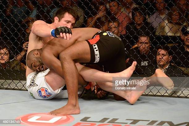 Rashad Evans takes down Chael Sonnen in their light heavyweight bout during the UFC 167 event inside the MGM Grand Garden Arena on November 16 2013...