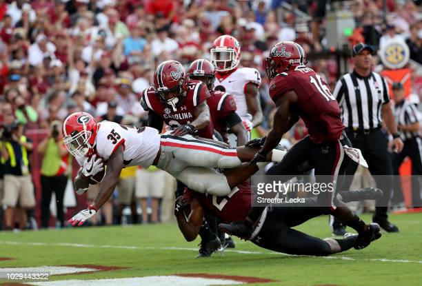 Rashad Fenton of the South Carolina Gamecocks watches as Brian Herrien of the Georgia Bulldogs dirves for a touchdown during their game at...