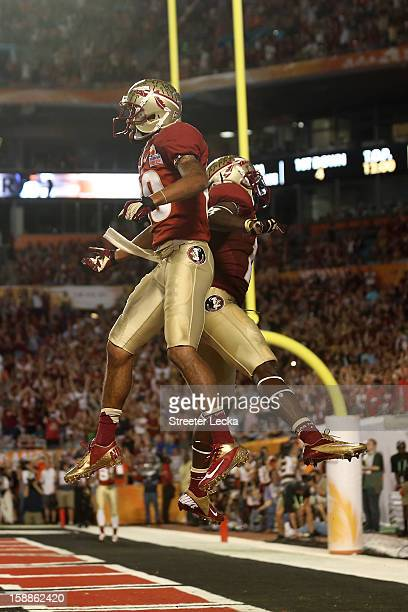 Rashad Greene and Greg Dent of the Florida State Seminoles celebrate after Greene scored a 6yard touchdown reception in the second quarter against...