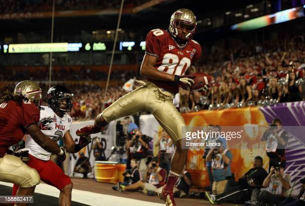 Rashad Greene of the Florida State Seminoles catches a 6yard touchdown reception in the second quarter against the Northern Illinois Huskies during...