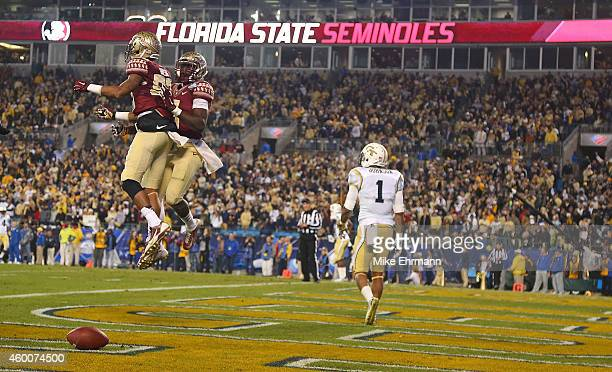Rashad Greene of the Florida State Seminoles celebrates with a teammate after a 2nd quarter touchdown against the Georgia Tech Yellow Jackets during...