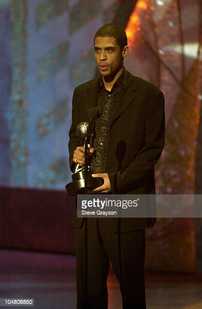 Rashad Haughton brother of singer Aaliyah accepts the award for Outstanding Female Artist on behalf of his late sister at the 33rd NAACP Image Awards...