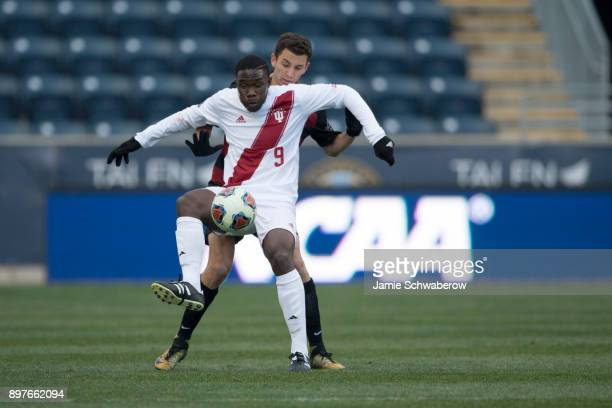 Rashad Hyacenth of Indiana University tries to control the ball against Adam Mosharrafa of Stanford University during the Division I Men's Soccer...