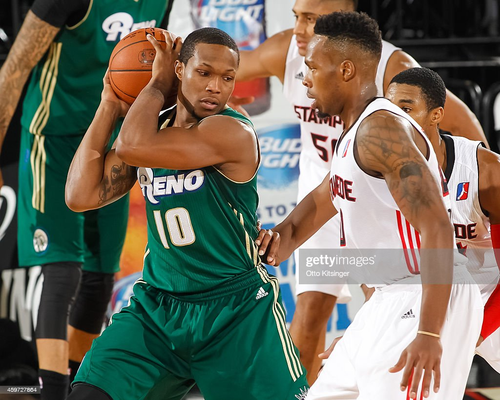 Ra'shad James #10 of the Reno Bighorns defends the ball from Nick Covington #20 of the Idaho Stampede during an NBA D-League game on November 28, 2014 at CenturyLink Arena in Boise, Idaho.