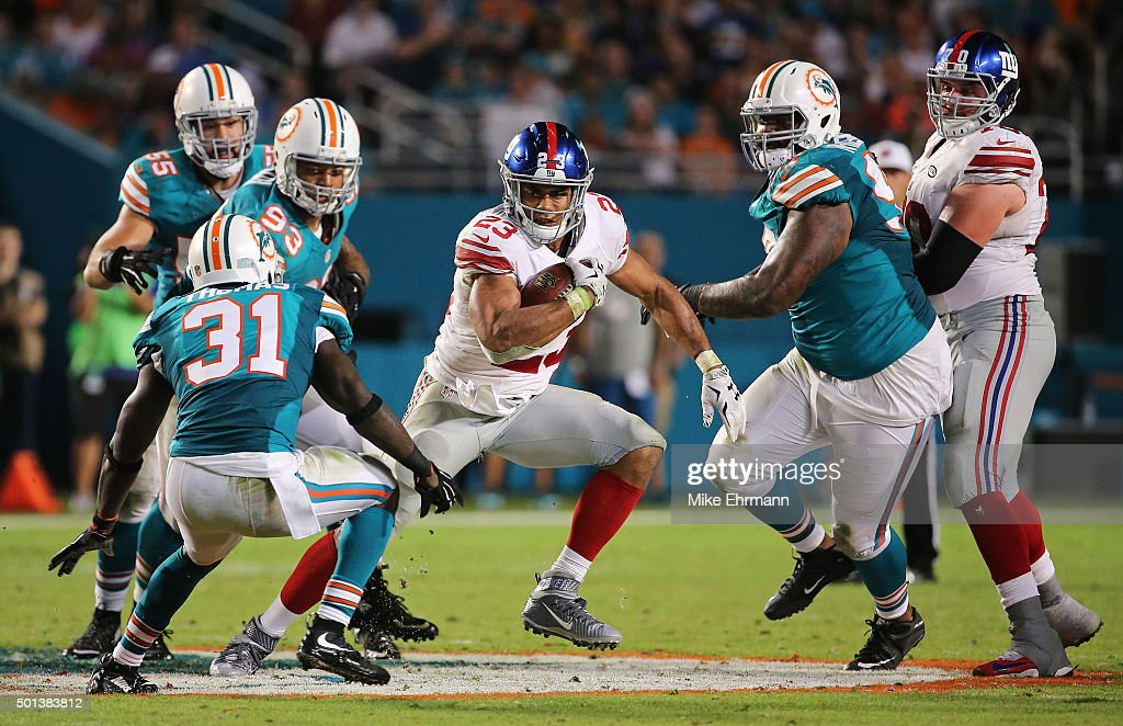 Rashad Jennings #23 of the New York Giants carries during the second half of the game against the Miami Dolphins at Sun Life Stadium on December 14, 2015 in Miami Gardens, Florida.