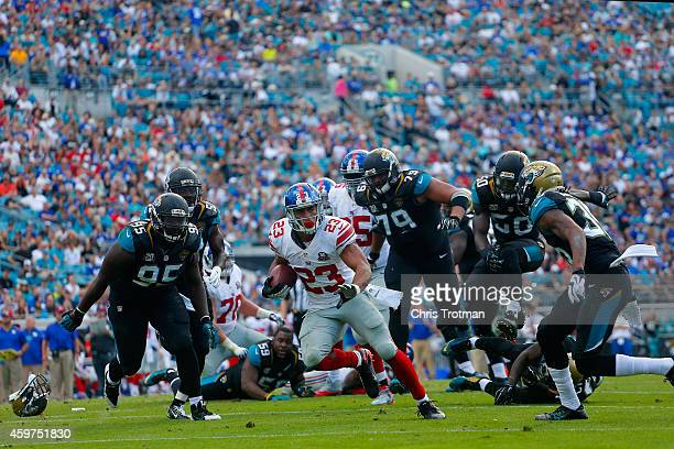 Rashad Jennings of the New York Giants runs the ball back for a touchdown in the second quarter against the Jacksonville Jaguars at EverBank Field on...