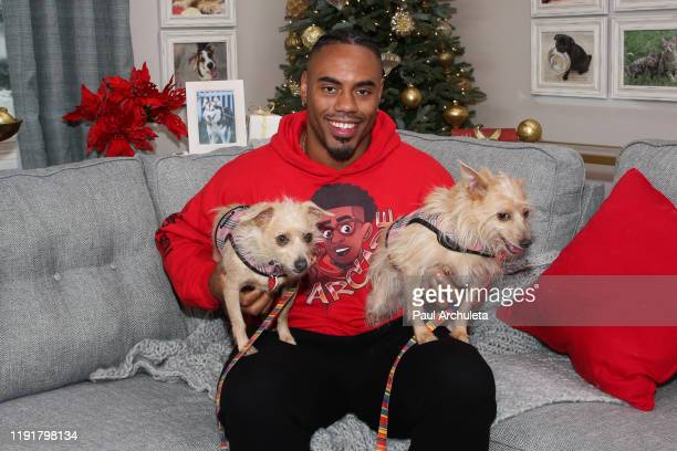 """Rashad Jennings poses with rescue dogs on the set of Hallmark Channel's """"Home & Family"""" at Universal Studios Hollywood on December 03, 2019 in..."""
