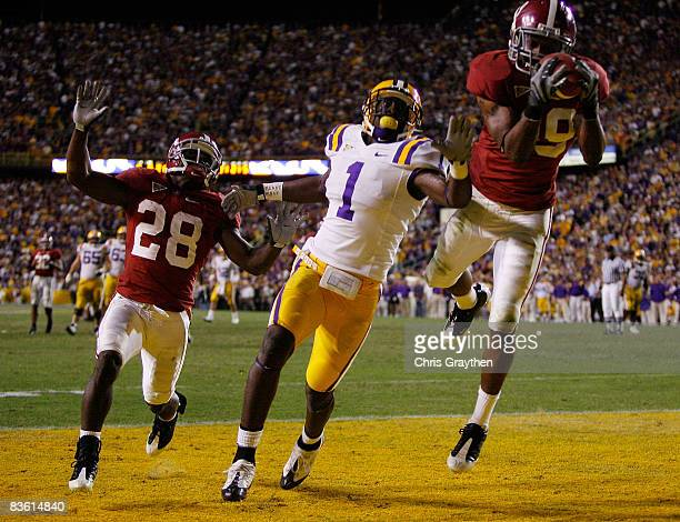 Rashad Johnson of the Alabama Crimson Tide makes an interception on a pass intended for Brandon LaFell of the Louisiana State University Tigers in...