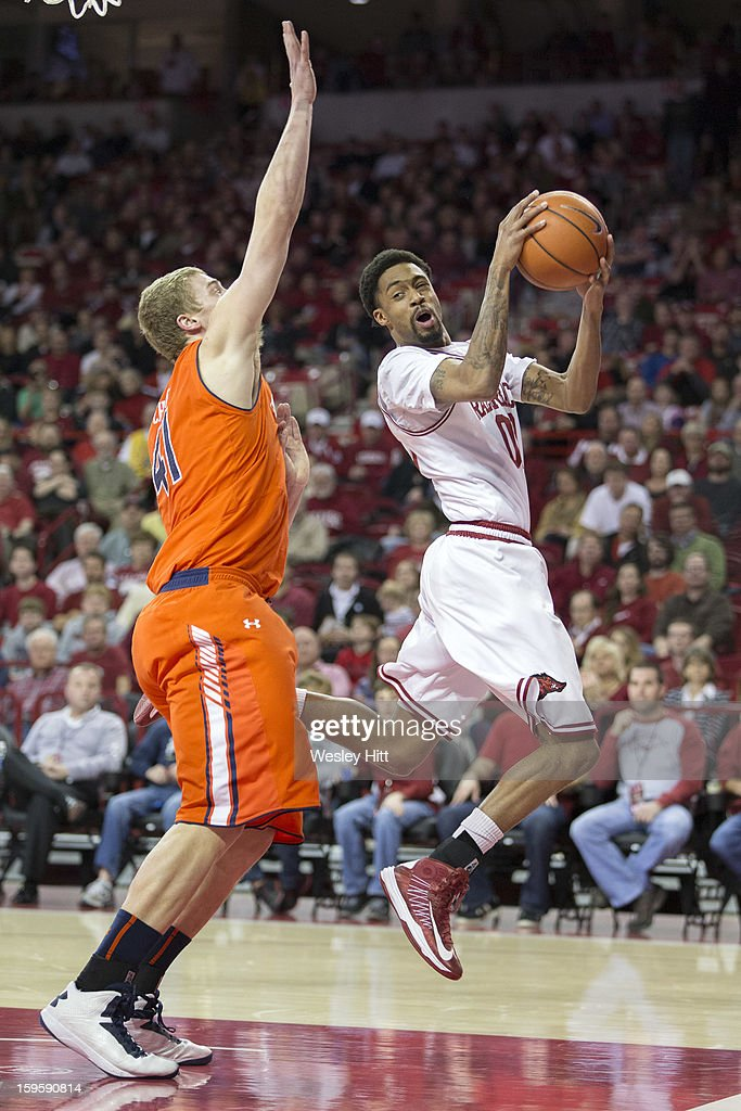 Rashad Madden #00 of the Arkansas Razorbacks goes up for a rebound past Rob Chubb #41 of the Auburn Tigers at Bud Walton Arena on January 16, 2013 in Fayetteville, Arkansas. The Razorbacks defeated the Tigers 88-80.