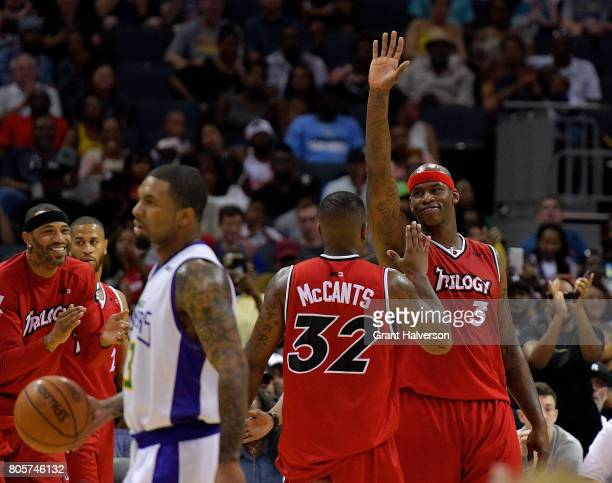 Rashad McCants and Al Harrington of Trilogy celebrate after a win over 3 Headed Monsters during week two of the BIG3 three on three basketball league...