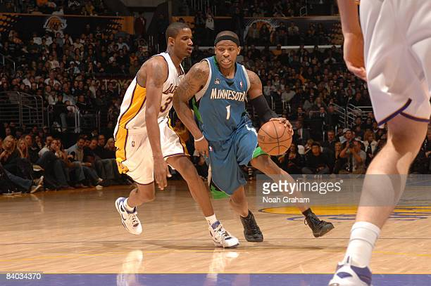 Rashad McCants of the Minnesota Timberwolves drives against Trevor Ariza of the Los Angeles Lakers at Staples Center on December 14 2008 in Los...