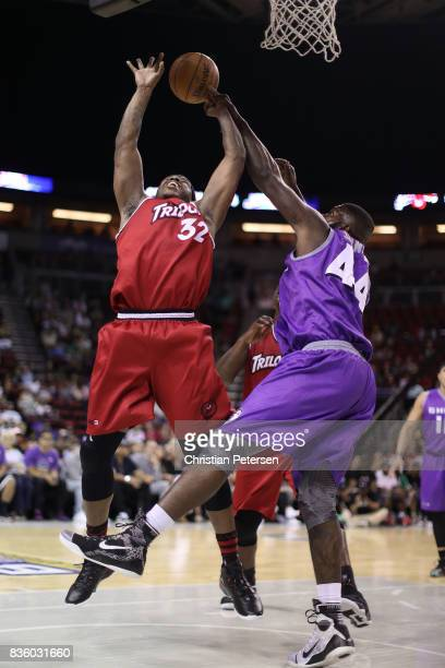 Rashad McCants of the Trilogy drives the ball against Ivan Johnson of the Ghost Ballers in week nine of the BIG3 threeonthree basketball league at...