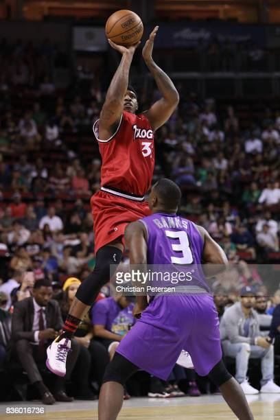 Rashad McCants of the Trilogy shoots the ball over Marcus Banks of the Ghost Ballers in week nine of the BIG3 threeonthree basketball league at...
