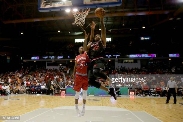 Rashad McCants of Trilogy attempts a shot while being guarded by Bonzi Wells of TriState during week five of the BIG3 three on three basketball...