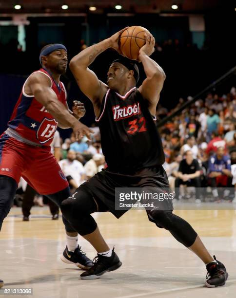 Rashad McCants of Trilogy handles the ball while being guarded by Mike James of TriState during week five of the BIG3 three on three basketball...