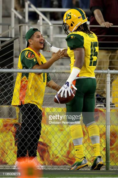 Rashad Ross of the Arizona Hotshots celebrates with a fan after scoring a touchdown in the third quarter against the San Antonio Commanders during...