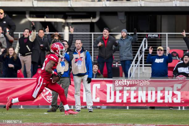 Rashad Ross of the DC Defenders scores a touchdown against the Seattle Dragons during the second half of the XFL game at Audi Field on February 8,...
