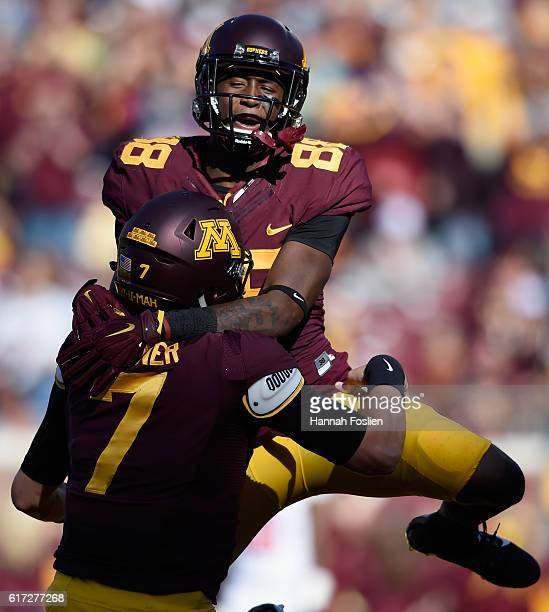 Rashad Still of the Minnesota Golden Gophers congratulates teammate Mitch Leidner on a touchdown against the Rutgers Scarlet Knights during the first...
