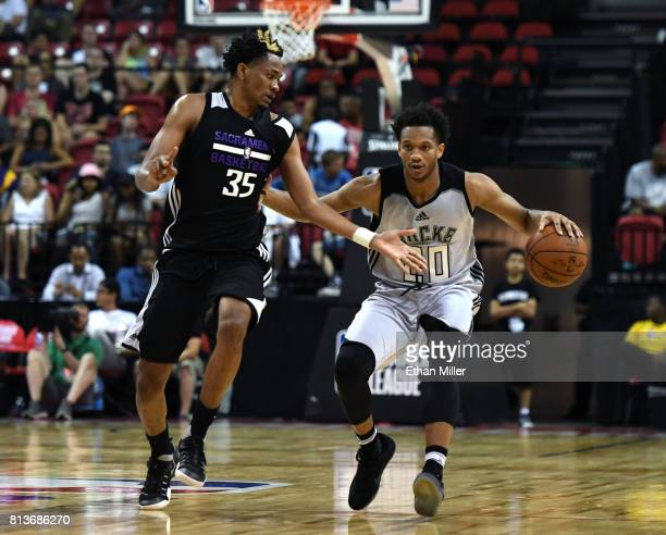 Rashad Vaughn of the Milwaukee Bucks brings the ball up the court against Luis Montero of the Sacramento Kings during the 2017 Summer League at the...