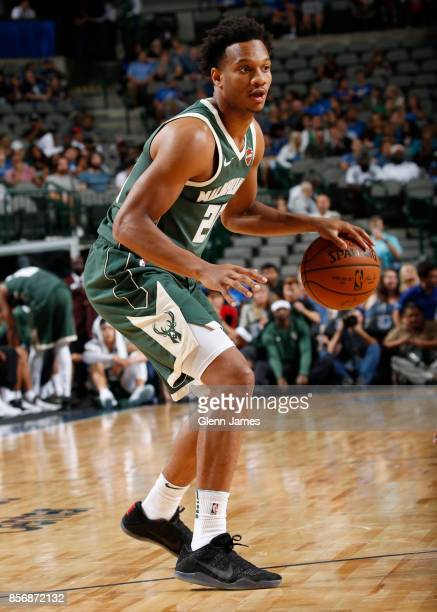Rashad Vaughn of the Milwaukee Bucks handles the ball against the Dallas Mavericks during the preseason game on October 2 2017 at the American...