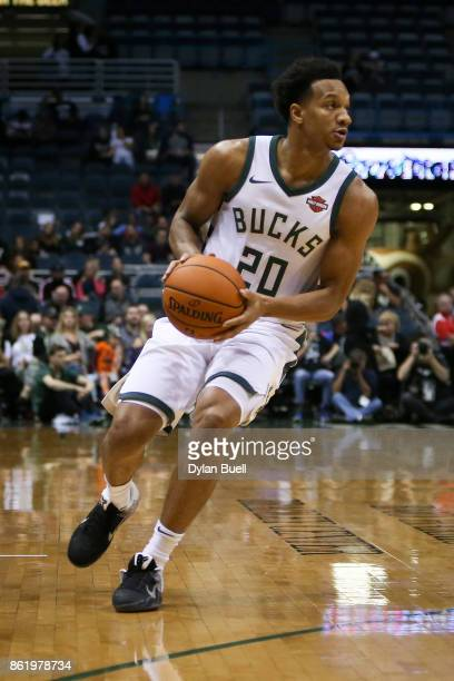 Rashad Vaughn of the Milwaukee Bucks handles the ball in the first quarter against the Detroit Pistons during a preseason game at BMO Harris Bradley...