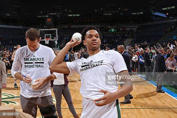 Rashad Vaughn of the Milwaukee Bucks throws merchandise to fans after the game against the Indiana Pacers on April 13 2016 at the BMO Harris Bradley...