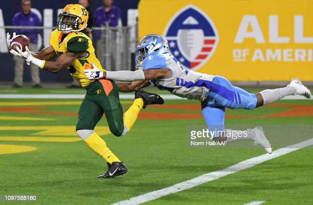 Rashad Ross of the Arizona Hotshots catches a touchdown pass while being guarded by CJ Smith of the Salt Lake Stallions during the first half of the...