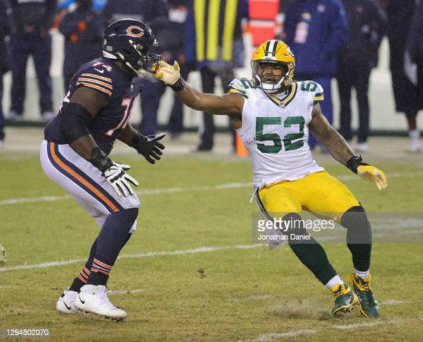 Rashan Gary of the Green Bay Packers rushes against Germain Ifedi of the Chicago Bears at Soldier Field on January 03, 2021 in Chicago, Illinois. The...