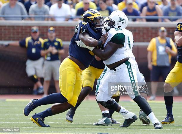 Rashan Gary of the Michigan Wolverines battles against Dejon Allen of the Hawaii Warriors during the second half on September 3 2016 at Michigan...