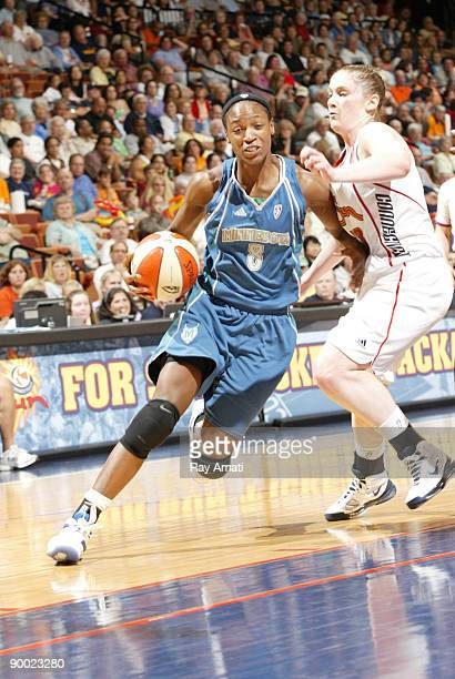 Rashanda McCants of the Minnesota Lynx drives past Lindsay Whalen of the Connecticut Sun during their game on August 22 2009 at Mohegan Sun Arena in...
