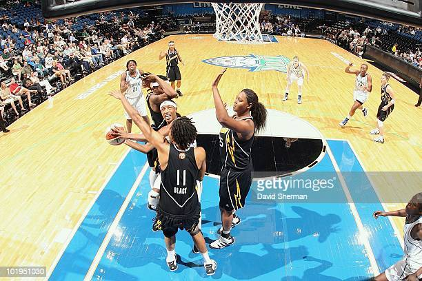 Rashanda McCants of the Minnesota Lynx goes to the basket against Chante Black and Kara Braxton of the Tulsa Shock during the game on May 23 2010 at...
