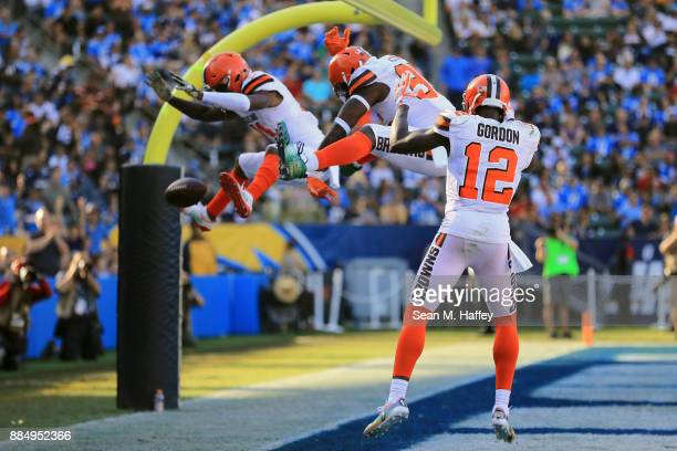 Rashard Higgins David Njoku and Josh Gordon of the Cleveland Browns celebrate after Njoku scored a touchdown during the second quarter of the game...