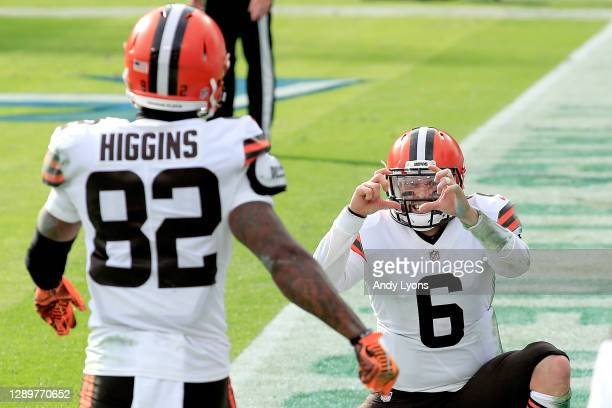 Rashard Higgins of the Cleveland Browns celebrates with quarterback Baker Mayfield after catching a pass for a touchdown against the Tennessee Titans...