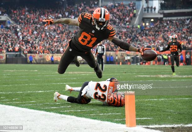 Rashard Higgins of the Cleveland Browns dives for a touchdown in front of Darius Phillips of the Cincinnati Bengals during the third quarter at...