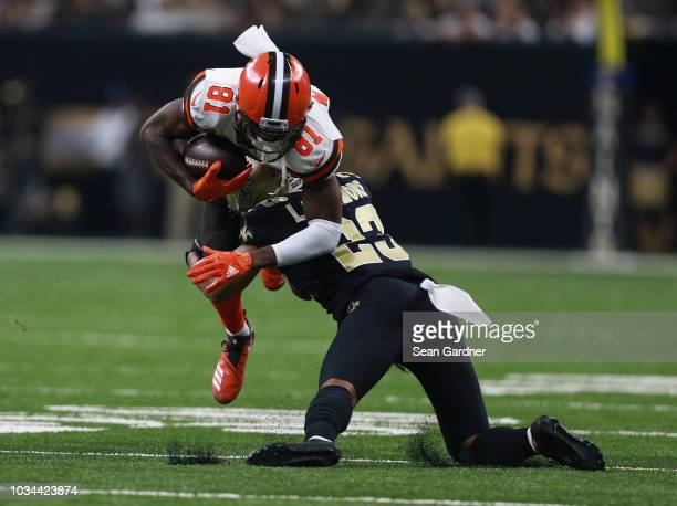 Rashard Higgins of the Cleveland Browns is tackled by Marshon Lattimore of the New Orleans Saints during the second quarter at MercedesBenz Superdome...