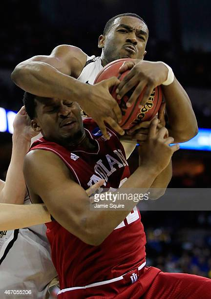 Rashard Kelly of the Wichita State Shockers and Stanford Robinson of the Indiana Hoosiers fight for a rebound during the second round of the 2015...
