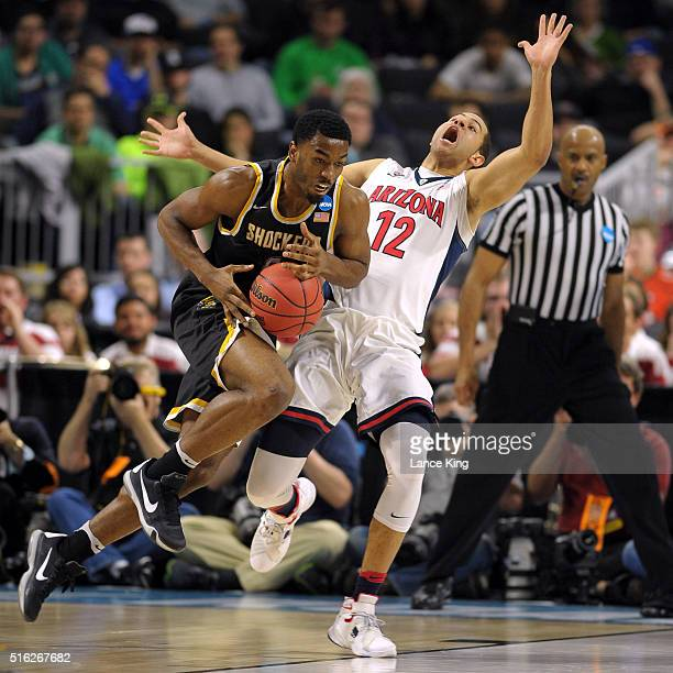 Rashard Kelly of the Wichita State Shockers drives against Ryan Anderson of the Arizona Wildcats during the first round of the 2016 NCAA Men's...