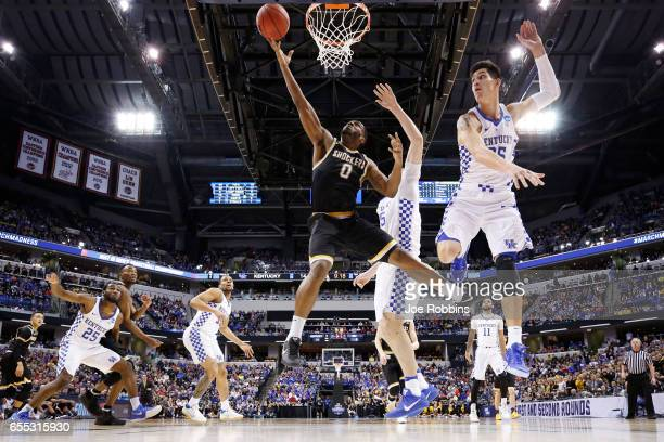Rashard Kelly of the Wichita State Shockers drives to the basket against Derek Willis of the Kentucky Wildcats during the second round of the 2017...
