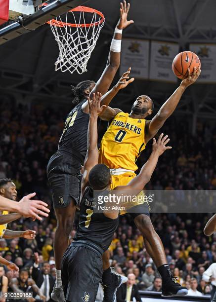 Rashard Kelly of the Wichita State Shockers drives to the basket against Chad Brown of the UCF Knights during the first half on January 25 2018 at...