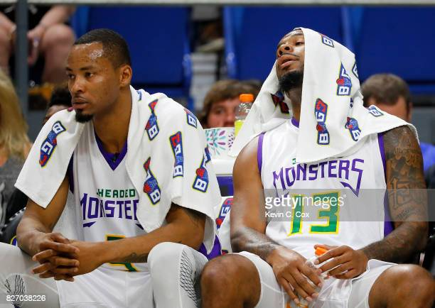 Rashard Lewis and Eddie Basden of the 3 Headed Monsters react on the bench during a time out during the game against the Ball Hogs during week seven...