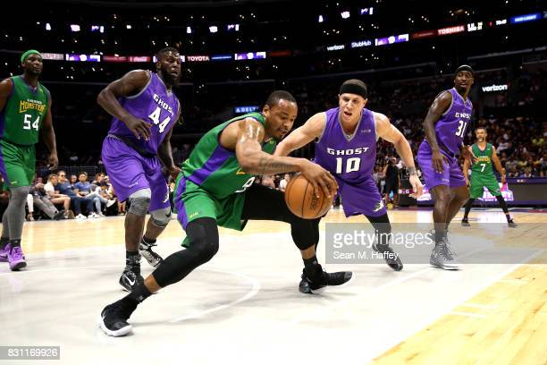Rashard Lewis of 3 Headed Monsters dribbles around Ivan Johnson and Mike Bibby of Ghost Killers during week eight of the BIG3 three on three...