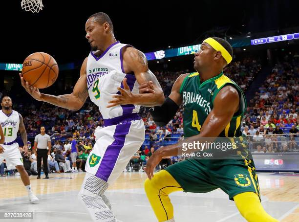 Rashard Lewis of the 3 Headed Monsters battles for possession against Derrick Byars of the Ball Hogs during week seven of the BIG3 three on three...