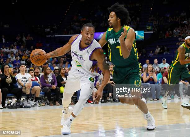 Rashard Lewis of the 3 Headed Monsters drives past Josh Childress of the Ball Hogs during week seven of the BIG3 three on three basketball league at...