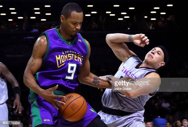 Rashard Lewis of the 3 Headed Monsters handles the ball against Mike Bibby of the Ghos Ballers during week one of the BIG3 three on three basketball...