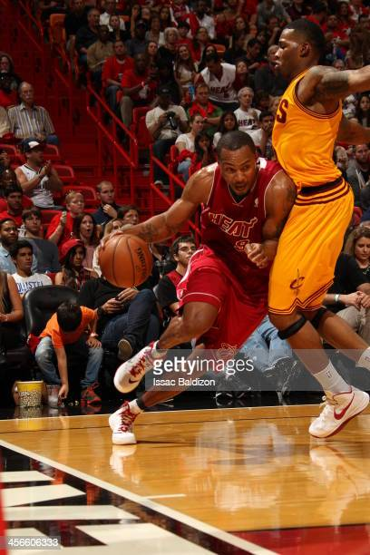 Rashard Lewis of the Miami Heat drives baseline against the Cleveland Cavaliers on December 14 2013 at American Airlines Arena in Miami Florida NOTE...