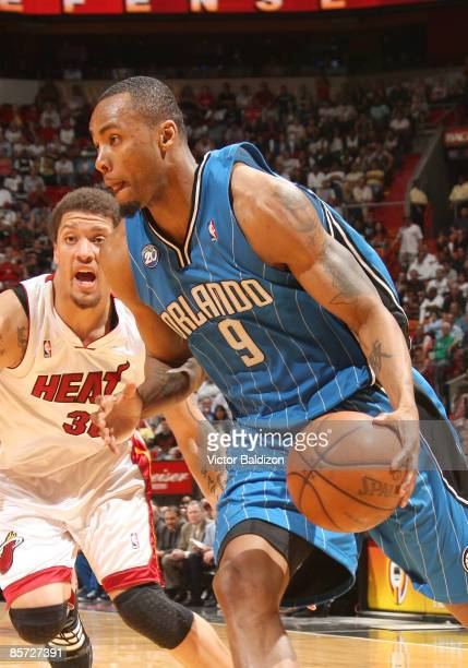 Rashard Lewis of the Orlando Magic drives against Michael Beasley of the Miami Heat on March 30 2009 at the American Airlines Arena in Miami Florida...