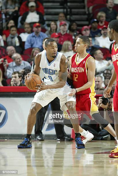 Rashard Lewis of the Orlando Magic drives the ball past Kevin Martin of the Houston Rockets on February 24 2010 at the Toyota Center in Houston Texas...