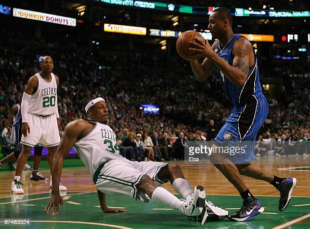 Rashard Lewis of the Orlando Magic plows into Paul Pierce of the Boston Celtics in Game Seven of the Eastern Conference Semifinals during the 2009...
