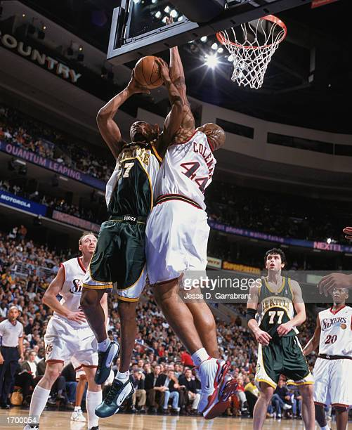 Rashard Lewis of the Seattle Sonics puts up a shot against Derrick Coleman of the Philadelphia 76ers at First Union Center on December 11, 2002 in...
