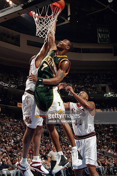 Rashard Lewis of the Seattle Sonics shoots against Kenny Thomas and Derrick Coleman of the Philadelphia 76ers during the game at Wachovia Center on...